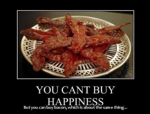 "Meme saying ""You can't buy hapiness, but you can buy bacon which is the same thing"""